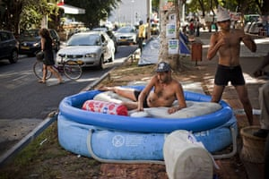 FTA: Oded Balilty: Israelis cool off in a pool at a protest tent encampment