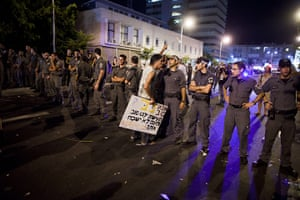 FTA: Oded Balilty: Israeli police officers line up in front of a protester at the end of rally