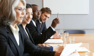 Men and women in a boardroom