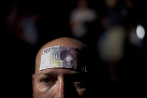 FTA: Oded Balilty: An Israeli man with a bill attached to his forehead at a protest