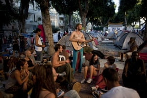 FTA: Oded Balilty: Israeli protesters play music in a protest tent encampment