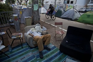 FTA: Oded Balilty: An Israeli protester sleeps on a couch in a protest tent encampment