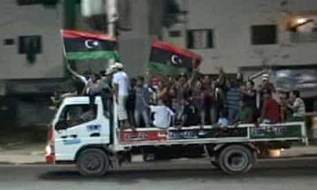 Libyans in Misrata celebrate the arrival of rebel fighters in Tripoli