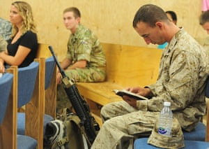 Afghanistan baptism: A young US Marine reads through a section of his bible