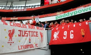 Liverpool fans display banners in support of the Hillsborough victims