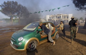 Gaddafi's compound falls: Rebel push the car inside the main compound
