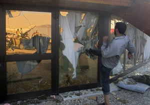 Gaddafi's compound falls: A rebel fighter breaks the glass of Gaddafi's tent inside the compound