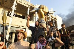 Gaddafi's compound falls: Libyan rebels celebrate at Bab Al-Aziziya compound in Tripoli