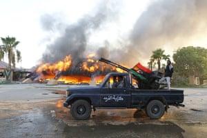 Gaddafi's compound falls: Libyan rebels celebrate at the Bab al-Aziziya compound in Tripoli