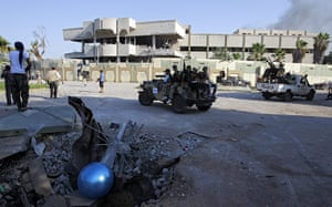 Gaddafi's compound falls: Rebel cars inside the main compound after it was stormed