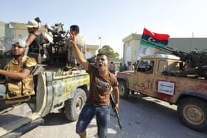Gaddafi's compound falls: Libyan rebel fighters celebrate after their entering the compound