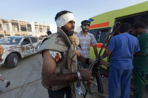Gaddafi's compound falls: An injured fighter in the compound