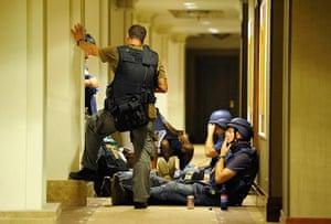 Media in Rixos hotel: Members of the media gather in a corridor at the Rixos hotel in Tripoli