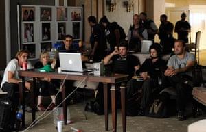 Media in Rixos hotel: Members of the media watch a film in the basement Rixos Hotel, Tripoli