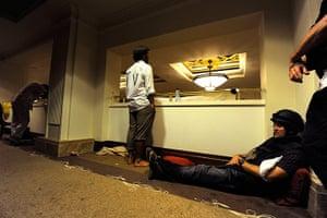 Media in Rixos hotel: Members of the media waits in a corridor at the Rixos hotel in Tripoli