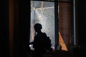 Media in Rixos hotel: Media walk past shattered window, Rixos Hotel, Tripoli