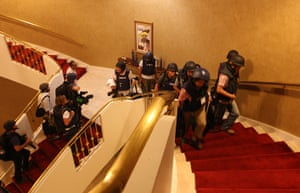 Media in Rixos hotel: Foreign journalists in protective gear are seen climbing the stairs