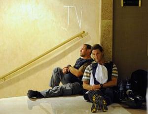 Media in Rixos hotel: Two members of the media sit in a corridor, Rixos Hotel, Tripoli