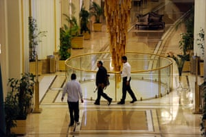 Media in Rixos hotel: An armed man loyal to Muammar Gaddafi walks through the Rixos hotel