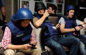 Media in Rixos hotel: Members of the media checking their phones, Rixos Hotel, Tripoli