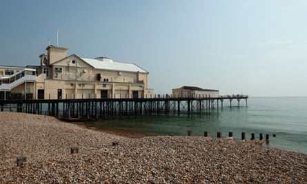 Bognor Regis Pier and beach with a cloudless blue sky. Summer afternoon. Editorial use only.