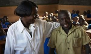 Claude with his schoolteacher
