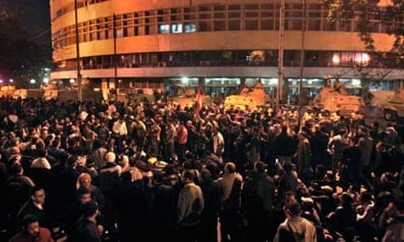 Anti-government protesters surround the state television building in Cairo in February