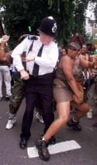 A policeman joins Notting Hill carnival 2001