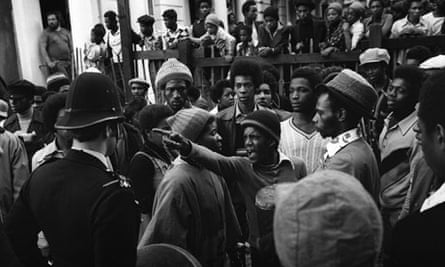 A reveller confronts a policeman at the 1976 Notting Hill carnival.