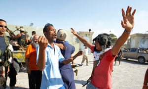 Libyan rebel fighters celebrate after they entered the Bab al Aziziya  compound in Tripoli