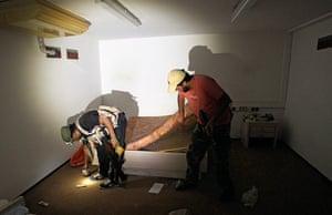 Bab al-Aziziya, Tripoli: Rebel fighters search a bedroom in the bunker, Bab al-Aziziya compound