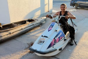 Bab al-Aziziya, Tripoli: A rebel pretends to drive a jet ski, Bab al-Aziziya, Tripoli