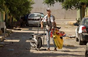 Bab al-Aziziya, Tripoli: A rebel loots leisure equipment, Bab al-Aziziya, Tripoli