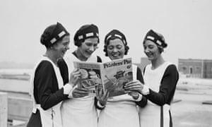 Four women reading 'Printers' Pie' magazine