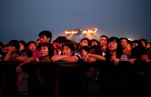 24 hours in pictures: Fans waiting for a performance to start at the FUN Music Festival , Beijing