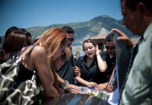 24 hours in pictures: Relatives of of the Casino Royale fire mourn, Mexico