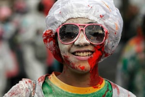 24 hours in pictures: A reveler covered in paints at the Notting Hill Carnival, London