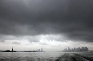 24 hours in pictures: New York City skyline in the dark clouds as Hurricane Irene approaches