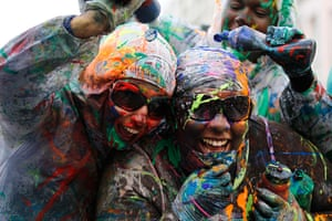 Notting Hill carnival: Revelers react being sprayed with paint during Notting Hill Carnival