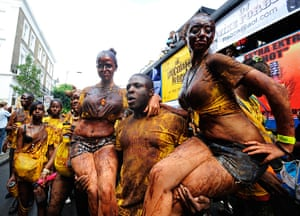 Notting Hill carnival: Performers covered in chocolate take part in the Notting Hill Carnival