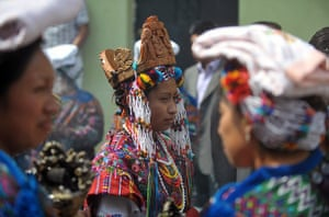 24 hours: Sumpango, Guatemala: A Beauty Queen attends the procession of San Agustin
