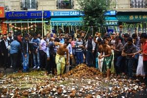 24 hours: Paris, France: Hindus break coconuts during Ganesha Chaturthi