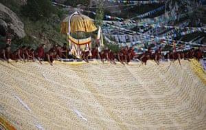 24 hours: Lhasa, Tibet Autonomous Region: Buddhist monks unfold a giant thangka