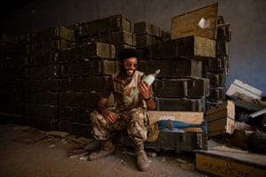 24 hours: Tripoli, Libya: Rebel fighter holds ammunition from one of Gaddafi's dumps