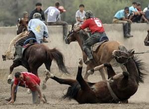24 hours: Bishkek, Kyrgyzstan: A horseman falls with his horse during Kok-boru