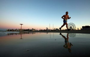 After Hurricane Irene: A man runs along the beach at Coney Island at dawn on in the Brooklyn