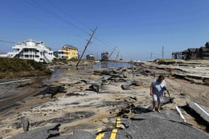 After Hurricane Irene: Residents walk along destroyed Highway 12, in Rodanthe