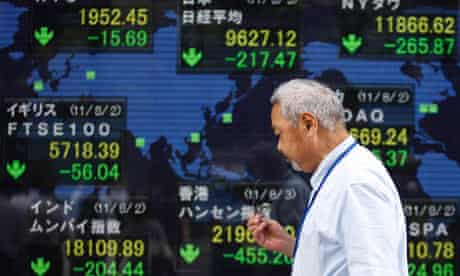 An electronic board showing falls in market indices around the world outside a brokerage in Tokyo