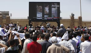 Mubarak in court: The crowd watches on a giant TV screen