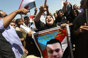 Mubarak in court: Relatives of those killed during the Tahrir Square demonstrations
